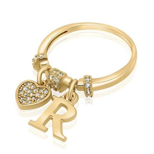 טבעת בשילוב אות ואלמנט משובץ